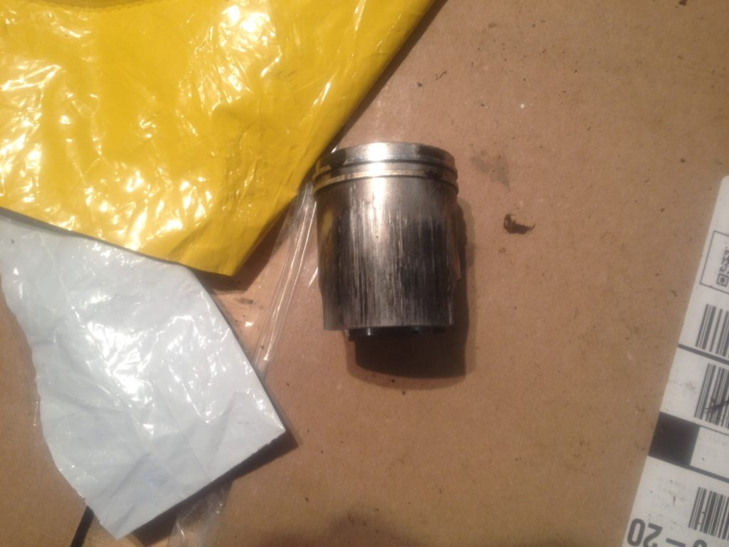 Here It Is I'm Pretty Sure This Is The One I Had Put It In My Old Parts  Box Along With Four Other Old Pistons But Narrowed It Down To This One